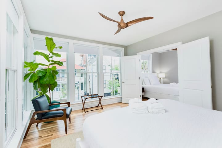 Huge master bedroom with amazing views of the town. Don't worry if you want to sleep in the blinds are full blackout shades so sleep as late as you'd like it's vacation! Read our reviews of how much our guests love our beds and linens