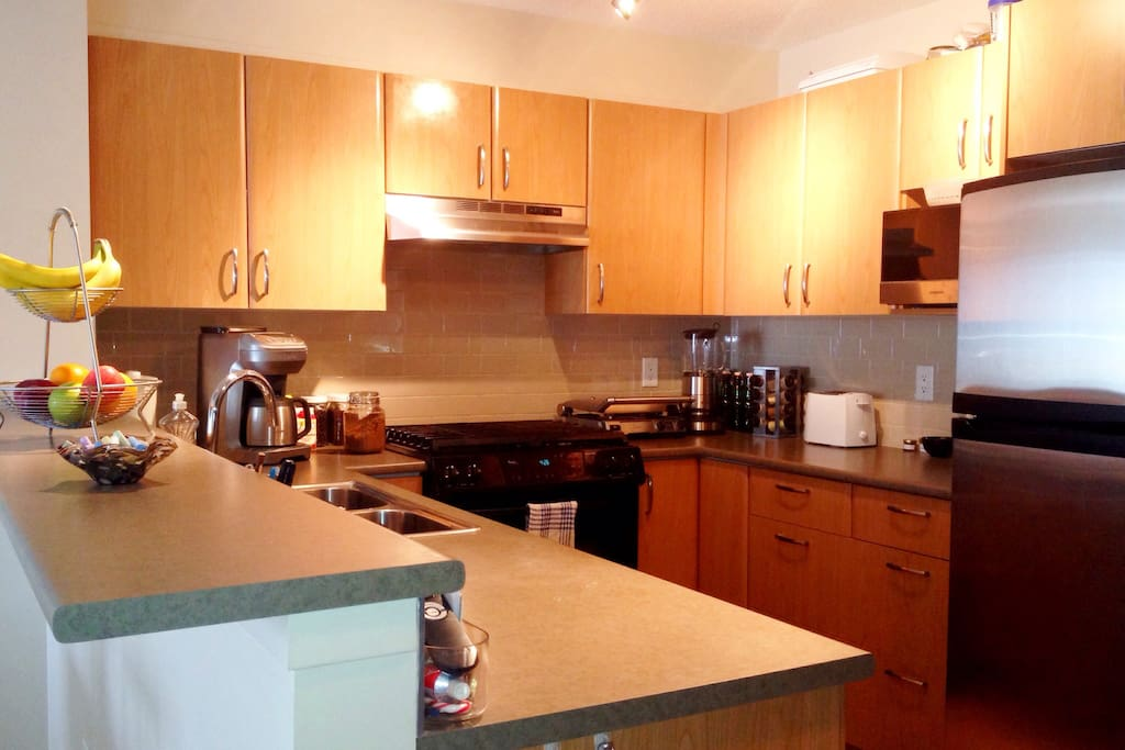 Clean kitchen with quality appliances to use.