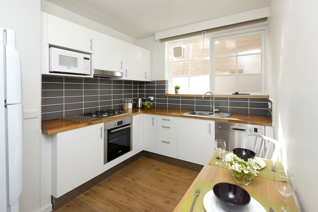 Modern, bright and roomy kitchen with German appliances.