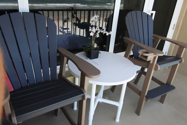 High-back bar chairs for your ultimate viewing pleasure.  You get to look over the balcony rail and not through them (many other rental units have small chairs and you must look through the railing).   Our table has enough space for outside dining.