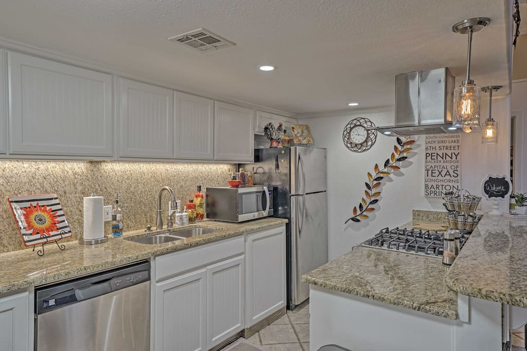 The renovated kitchen boasts stainless steel appliances & granite countertops!