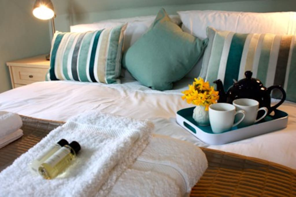 A restful night is a certainty in the king sized bed with white linen sheets