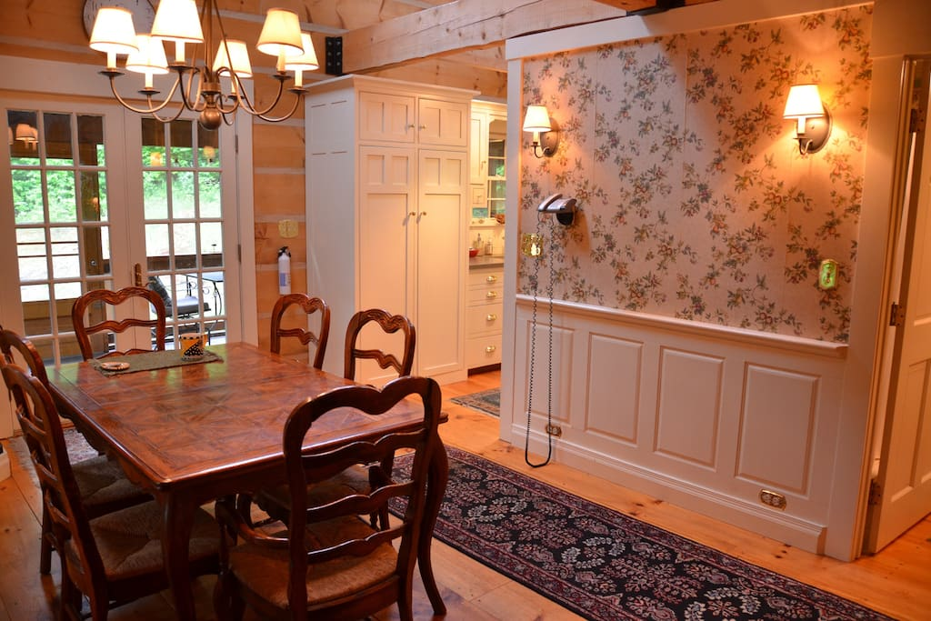 Dining area connects to kitchen and screened porch.