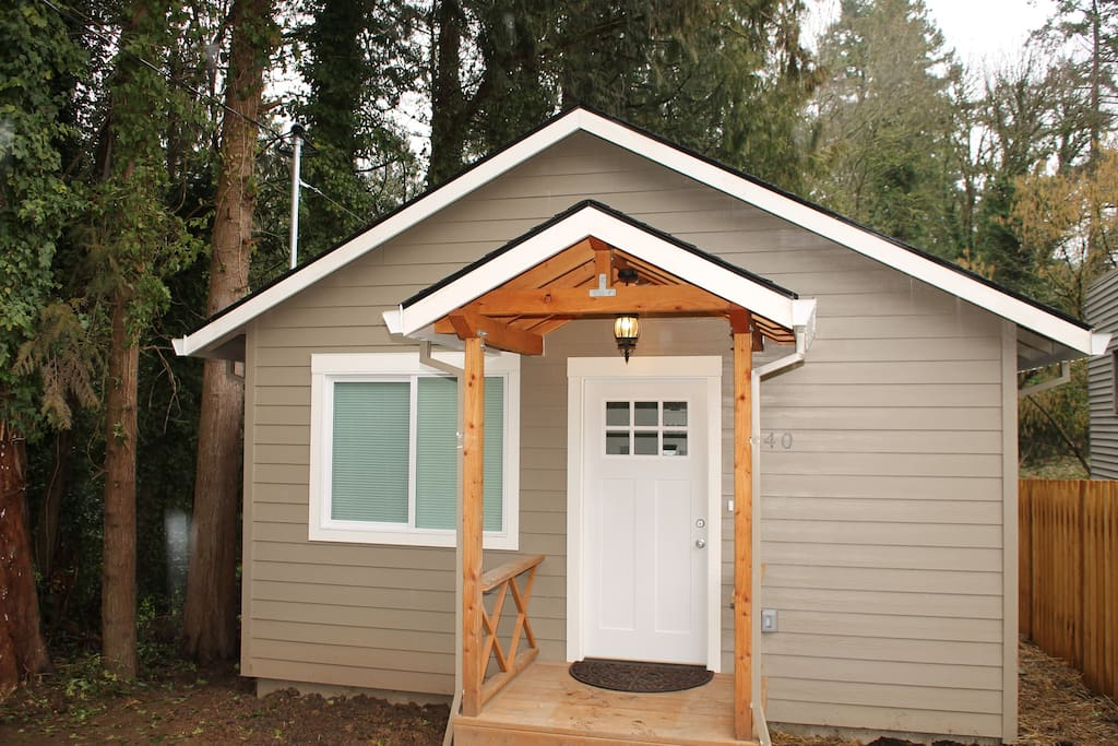 Front of house, small porch, green space with trees and Fanno Creek to the North.