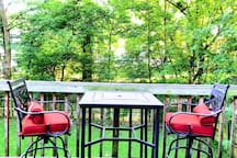 2nd floor deck with table and chairs, overlooking backyard. Perfect place to enjoy your morning coffee and books