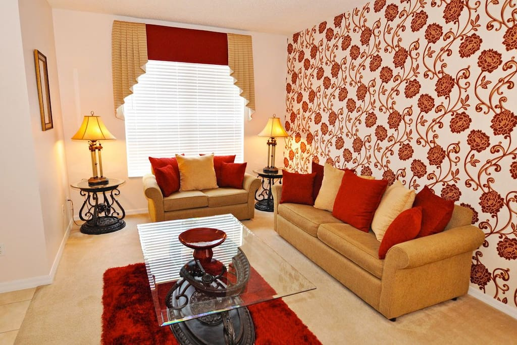 Relax in the formal lounge on the comfy sofas