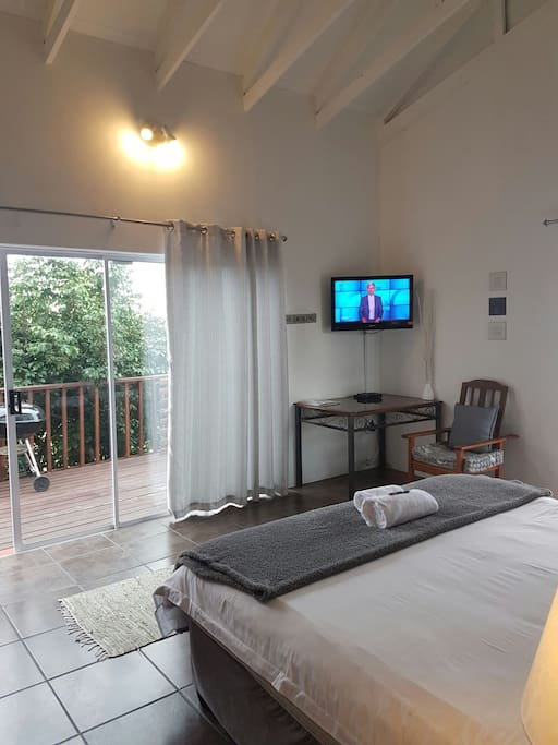Upstairs via wooden strairs, lovely spacious room with a private balcony and sea few. Full bathroom en-suite.