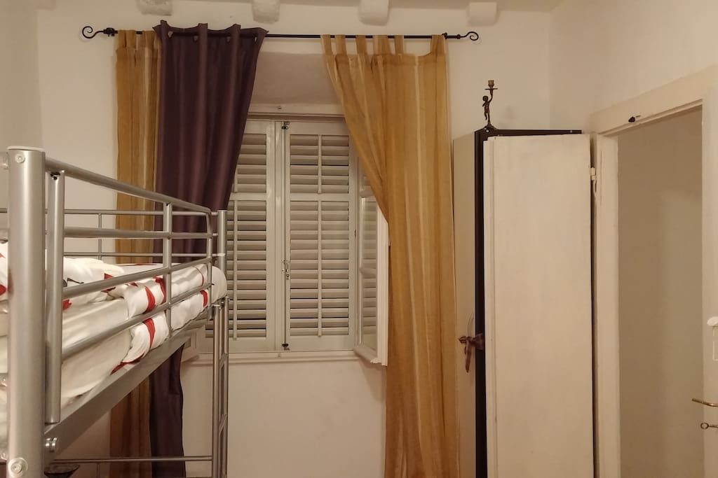 Double paned windows with shutters to keep out unwanted light and noise