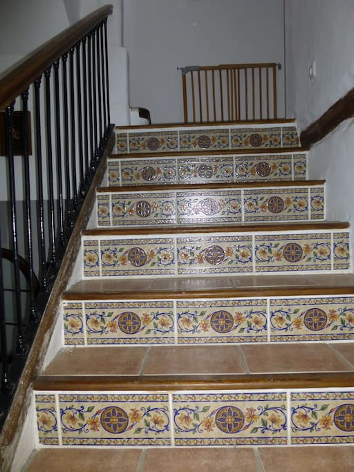 Tilework on stairs from 1st to 2nd story.