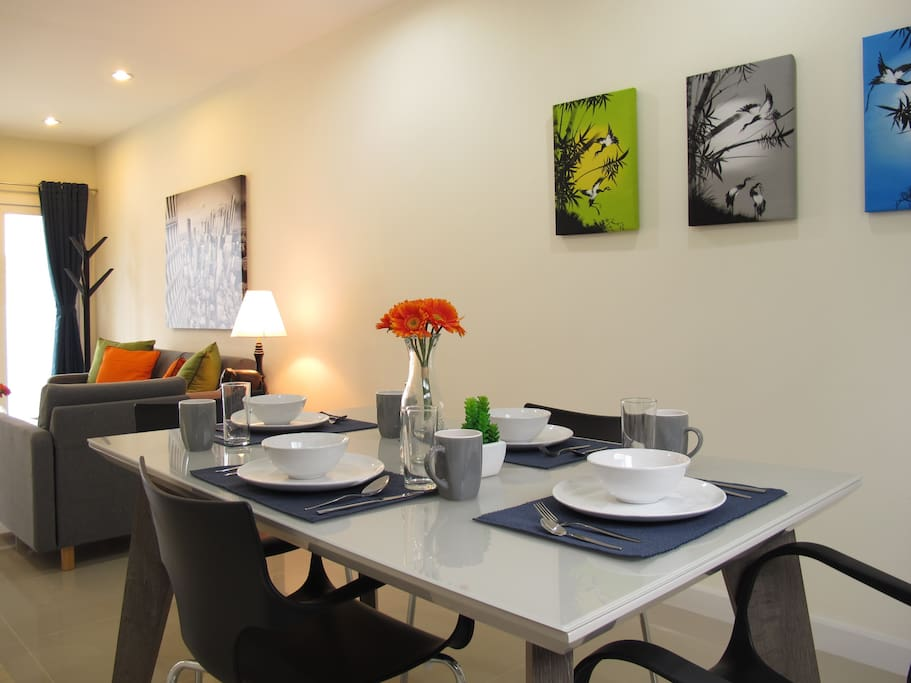Enjoy your meals at this large kitchen table with comfortable chairs.