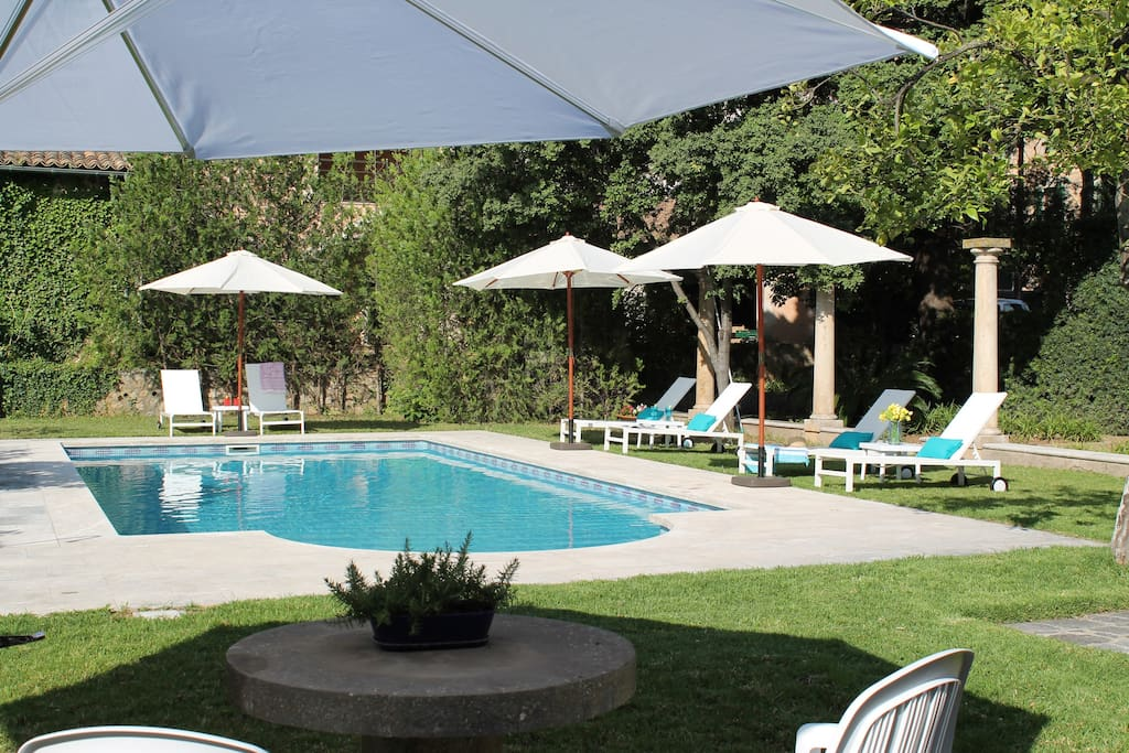 The beautiful pool area offers shade and a number of seating areas to enjoy a refreshing beverage in a serene setting.