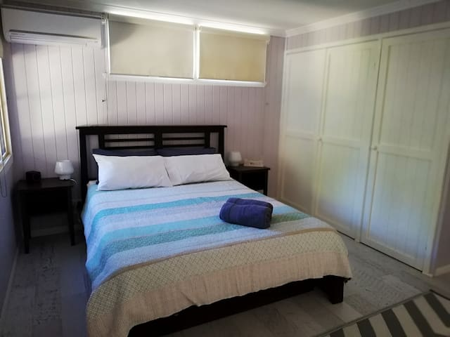 Large Main room. Queen and single bed. Portacot available. Large wardrobe space. Air con
