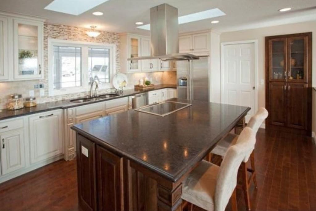 Gourmet kitchen with large granite island.