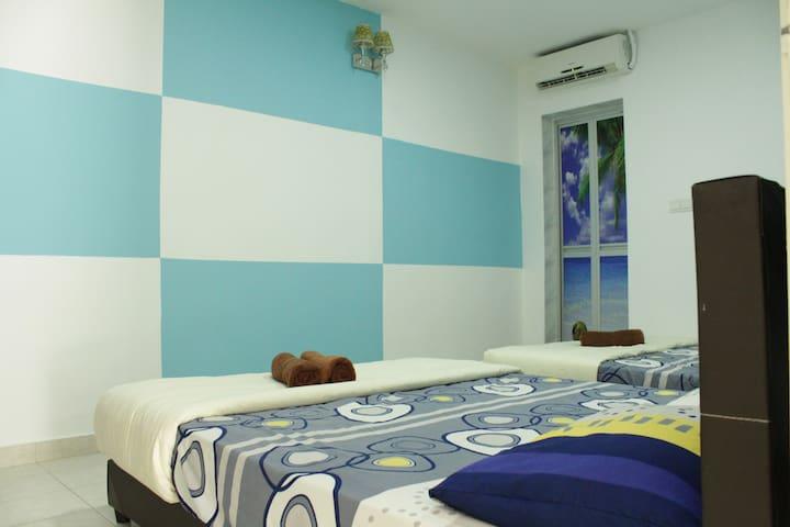 DesaTebrau-NewStar-Designed Quadruple Room