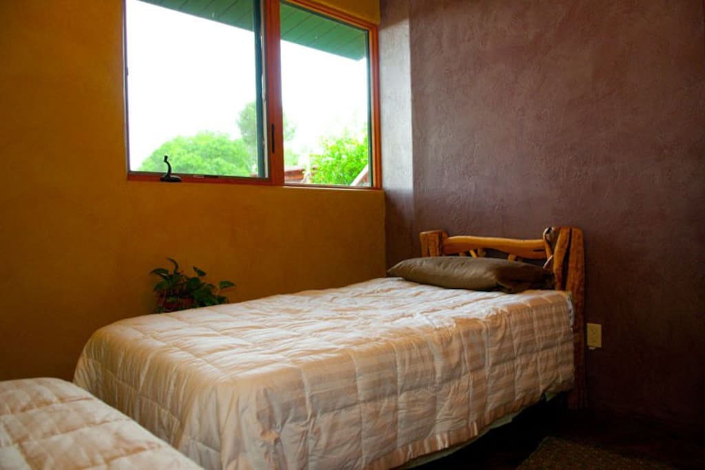 Enjoy a room with bedding and a nightstand and a luxury restroom and shower just yards away.