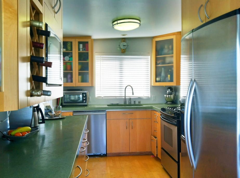 All stainless appliances and concrete countertops