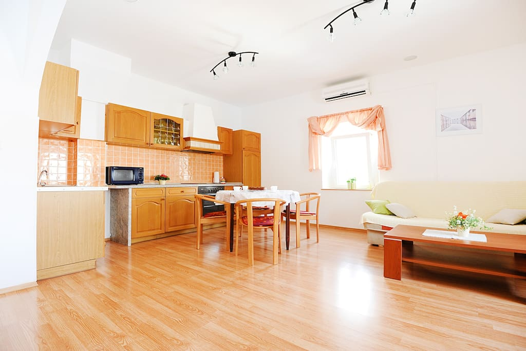lovely, pleasant and airy living room with kitchen