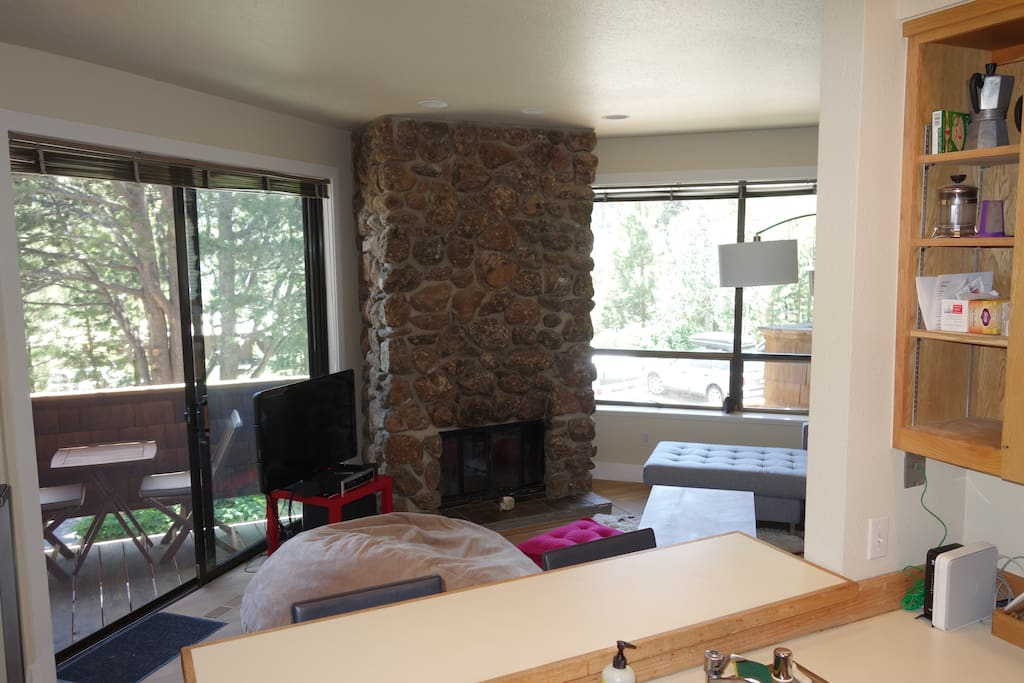 A wide-angle view of our living room from the kitchen