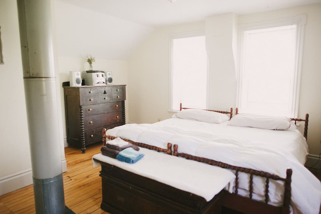 Bedroom #3 is a large, bright room with a kingsize bed and a doublesize futon/air mattress bed.
