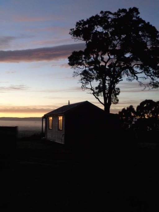 Our lovely new cabin. It faces East. That's the sun just creeping over the horizon.