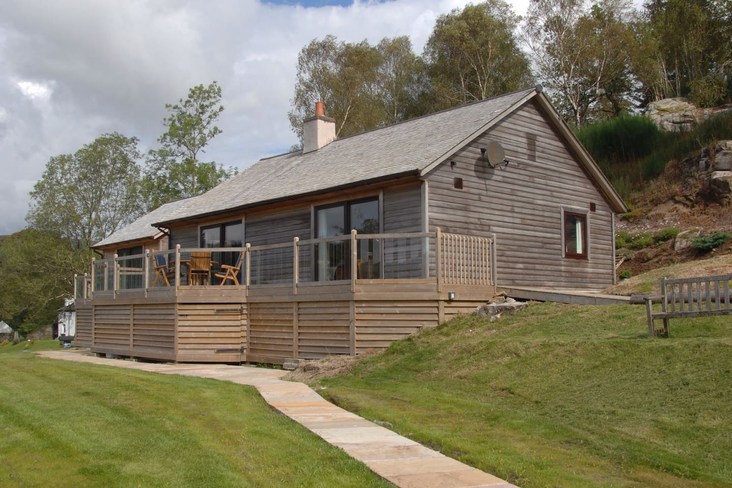 View of the main house which is Eco-cedar clad with cedar shingle roofing. The house was originally erected in 1967 and was completely renovated from a near derelict condition in 2006 having spent a year clearing the site which had become so overgrown wit