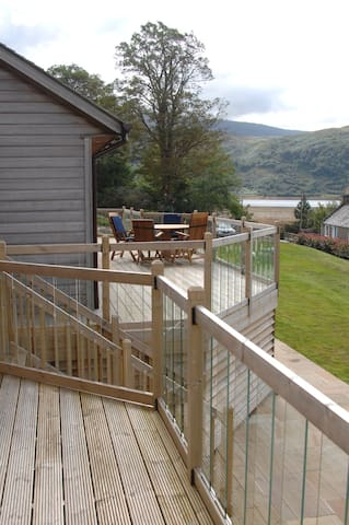 Extensive Wrap around raised decking allows for stunning views of Loch Sunart. Each master bedroom has sliding doors out onto the deck as does the main living room. Glass balustrades and LED deck lighting enhance the decking with a high quality teak table