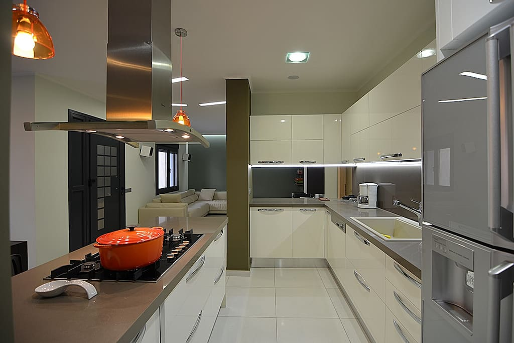 Fully equipped kitchen with large Fridge, juice maker, mixer, utensils, pans, casseroles