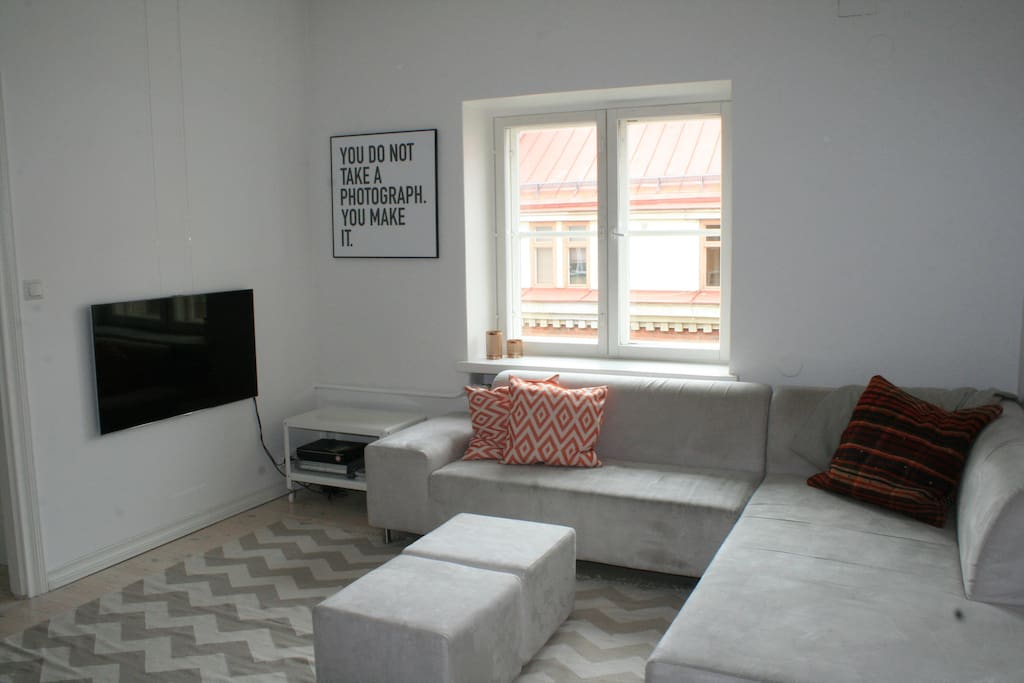Living/dining room area with a 46' Samsung TV and a huge couch