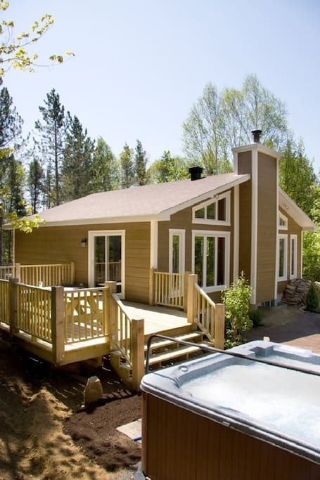 Beautiful Chalet with a large patio and hot tub.