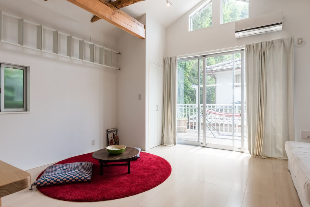 Bright living room upstairs with high ceiling