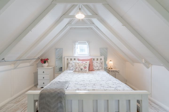 Loft style queen bedroom