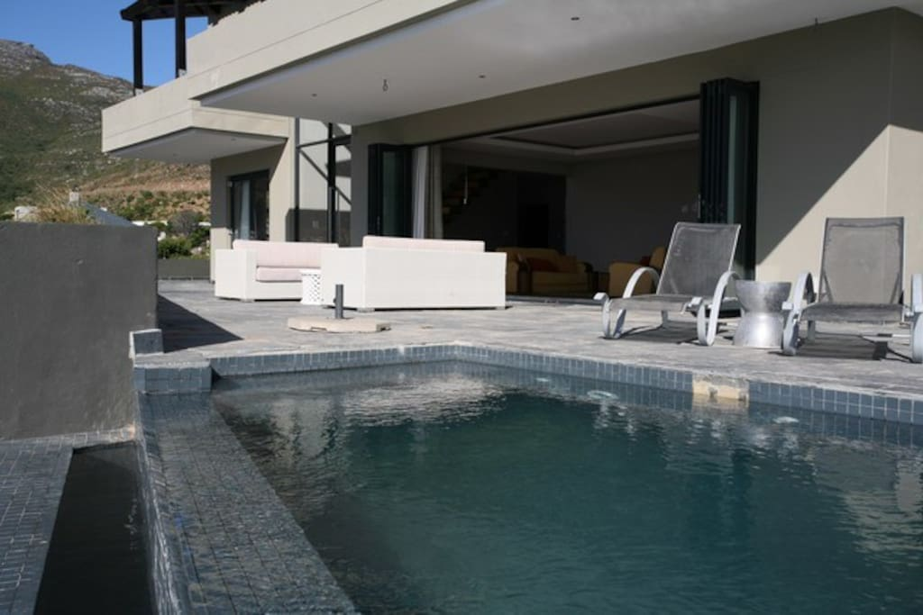 Expansive patio with plunge pool and magnificent views of the Hout Bay valley and beach.