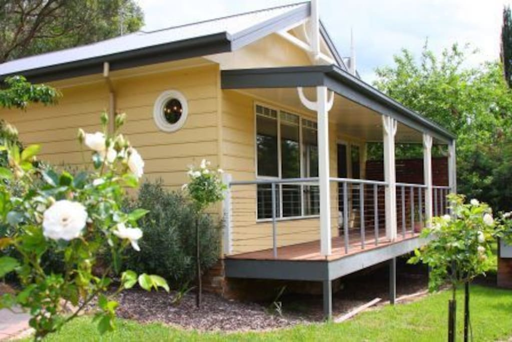 Unit 1, easy ramp access with cottage garden surrounding the unit.