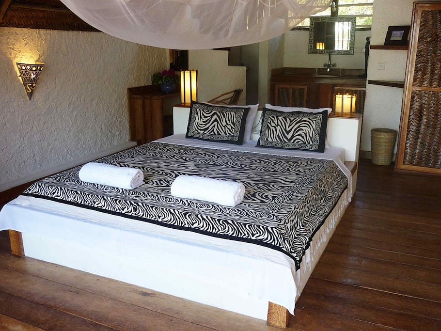 Our room is spacious with ensuite bathroom. It is fitted with a fan and mosquito net.
