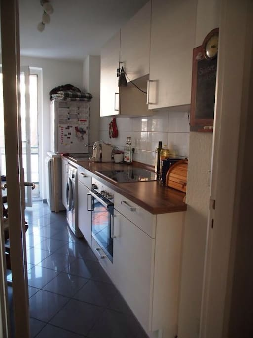 Kitchen with free coffee and sunny balcony