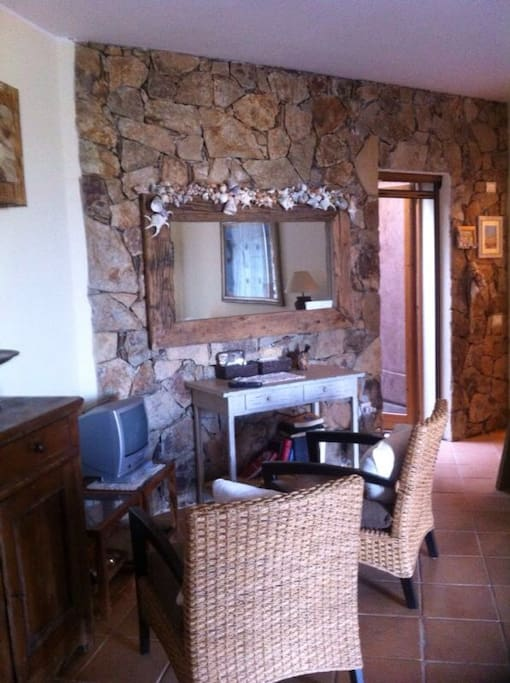 Living room with an authentic sardinian stones wall