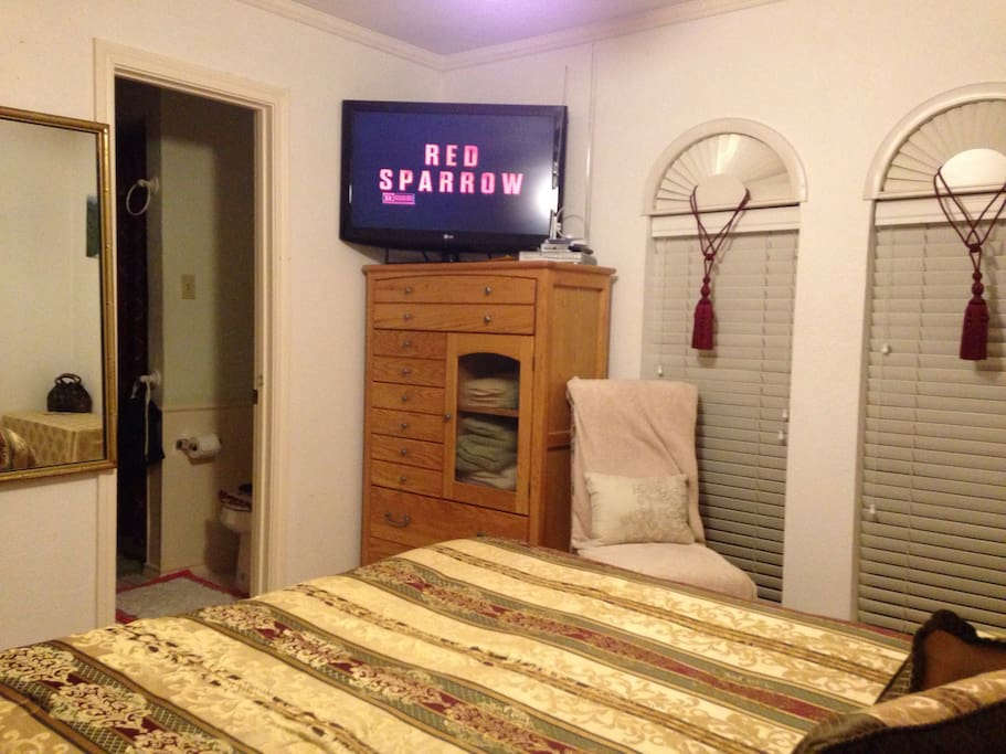 """Room has a 37"""" HDTV flatscreen with 80+ local channels by antenna and DVD player (movie library available)."""