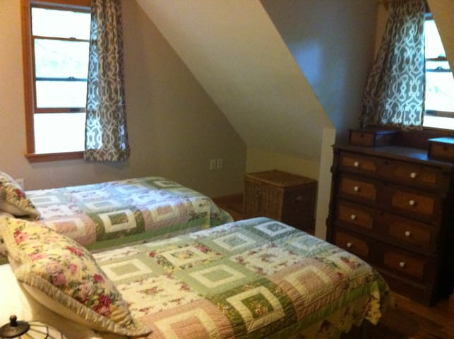 Lovely upstairs bedroom made up as twins.