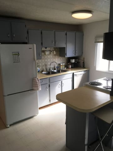 Kitchen has coffee maker, kettle, toaster oven, George foreman grill, dishes, glassware, pots and pans, etc...