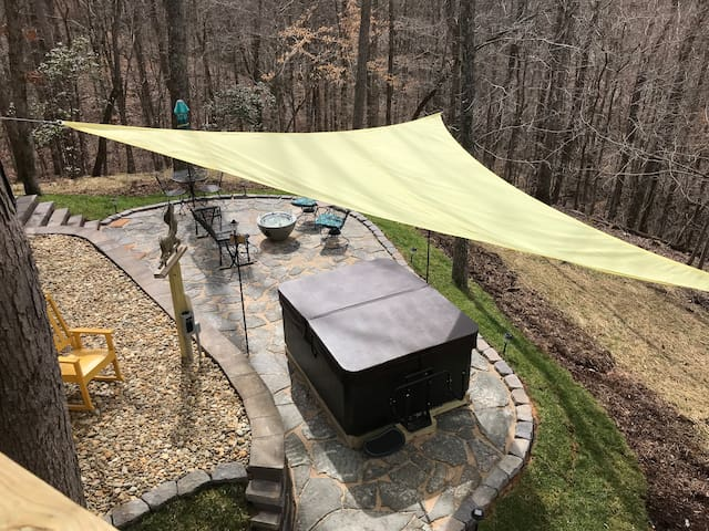 Winter View of patio from the back deck with hot tub made for two and fire pit. At night under neath the stars is the best time to be there!