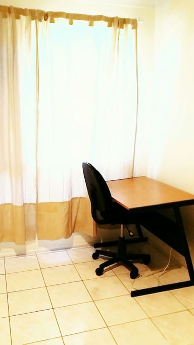 Desk and chair in room