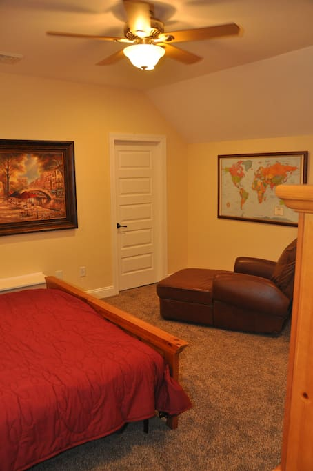 The comfortable bedroom offers a relaxing respite from the day's stress.