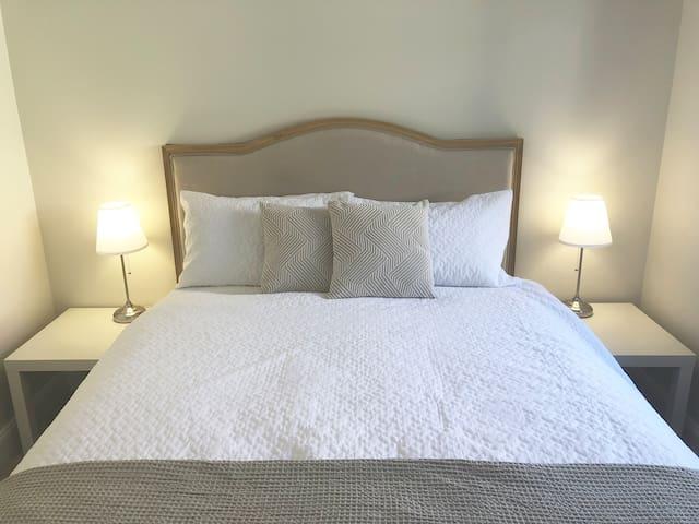 Bedroom 3. Queen bed and wardrobe.