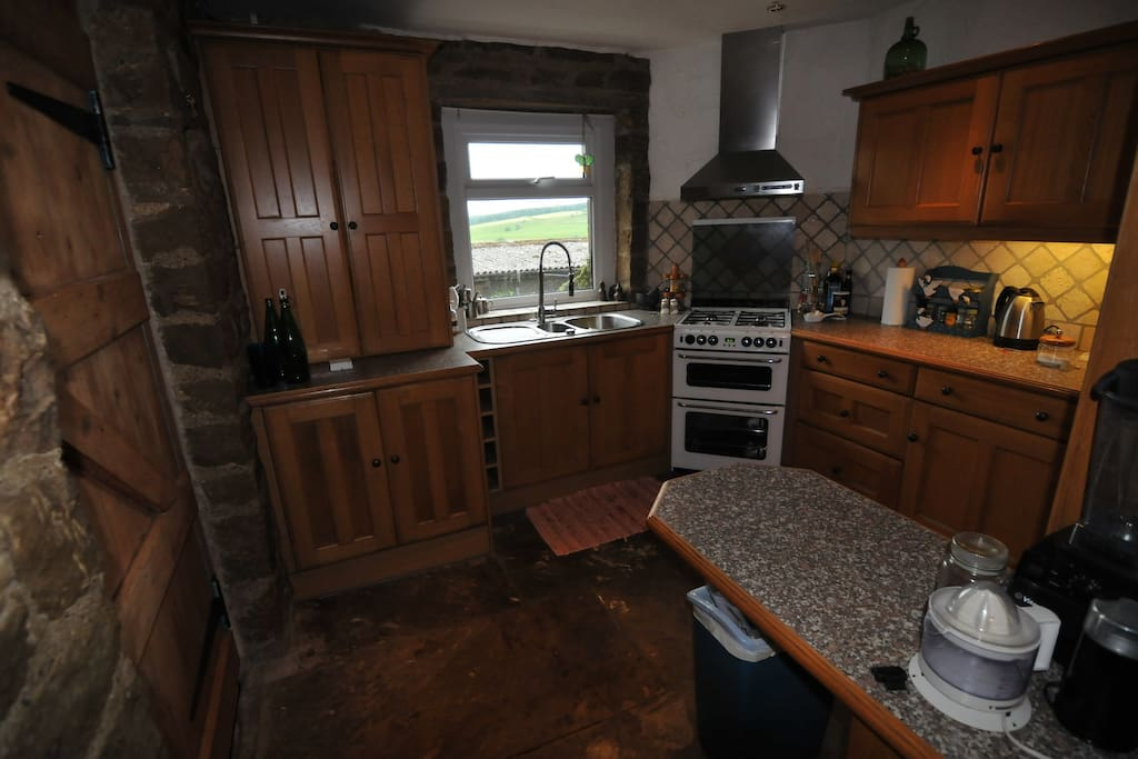 Full use of well equipped stone flagged rustic kitchen.