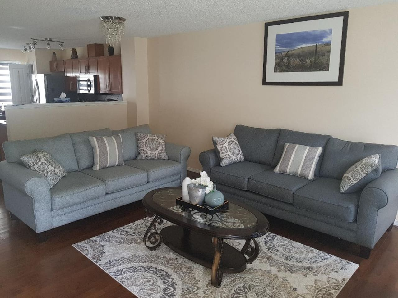 Warm and Cozy living area with huge TV for your relaxation and enjoyment