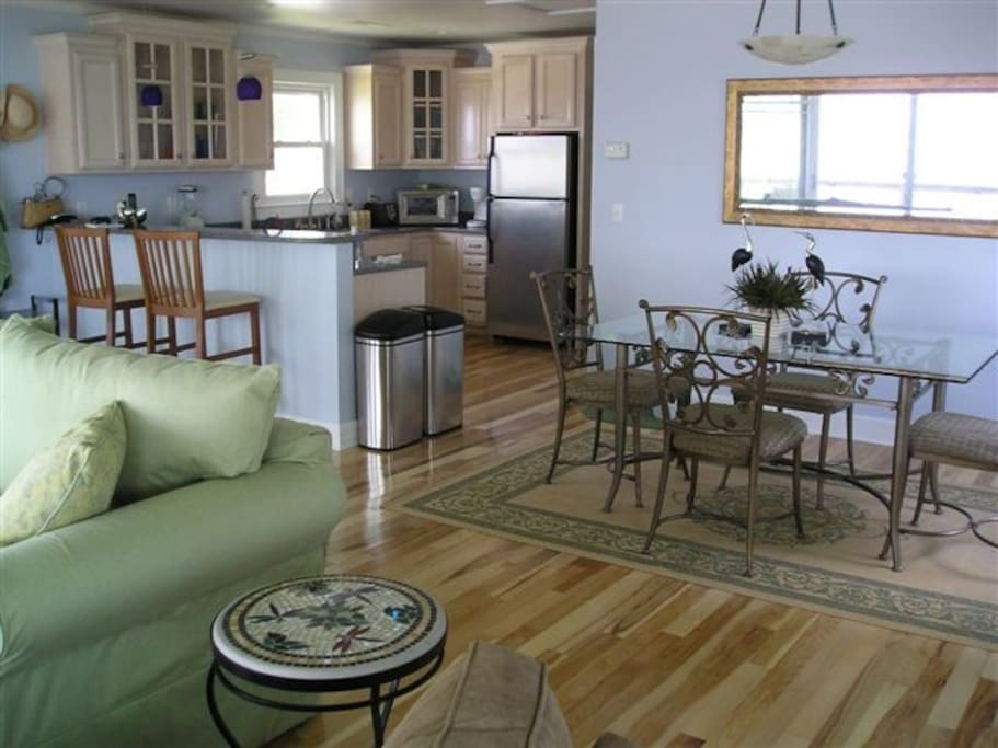 Open concept, hickory floors, quartz counters, stainless steel appliances make our home feel luxurious.