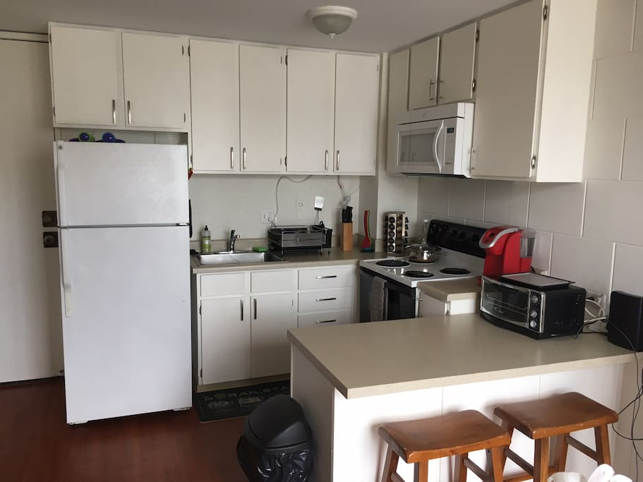 Full kitchen, with rice cooker, toaster oven, microwave and Keurig Coffee maker.