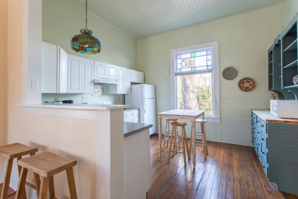 Fully-appointed kitchen with an eat-in breakfast bar and a high-top table with a gorgeous view of the Hemisfair Tower through the original stained glass window.