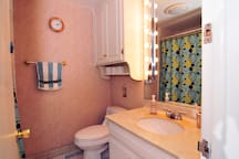 The bathroom, featuring vanity lighting for the mirror.