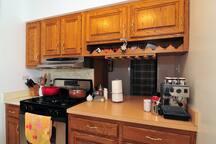 The stove and espresso machine in the kitchen.